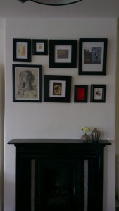 black painted frames above fireplace