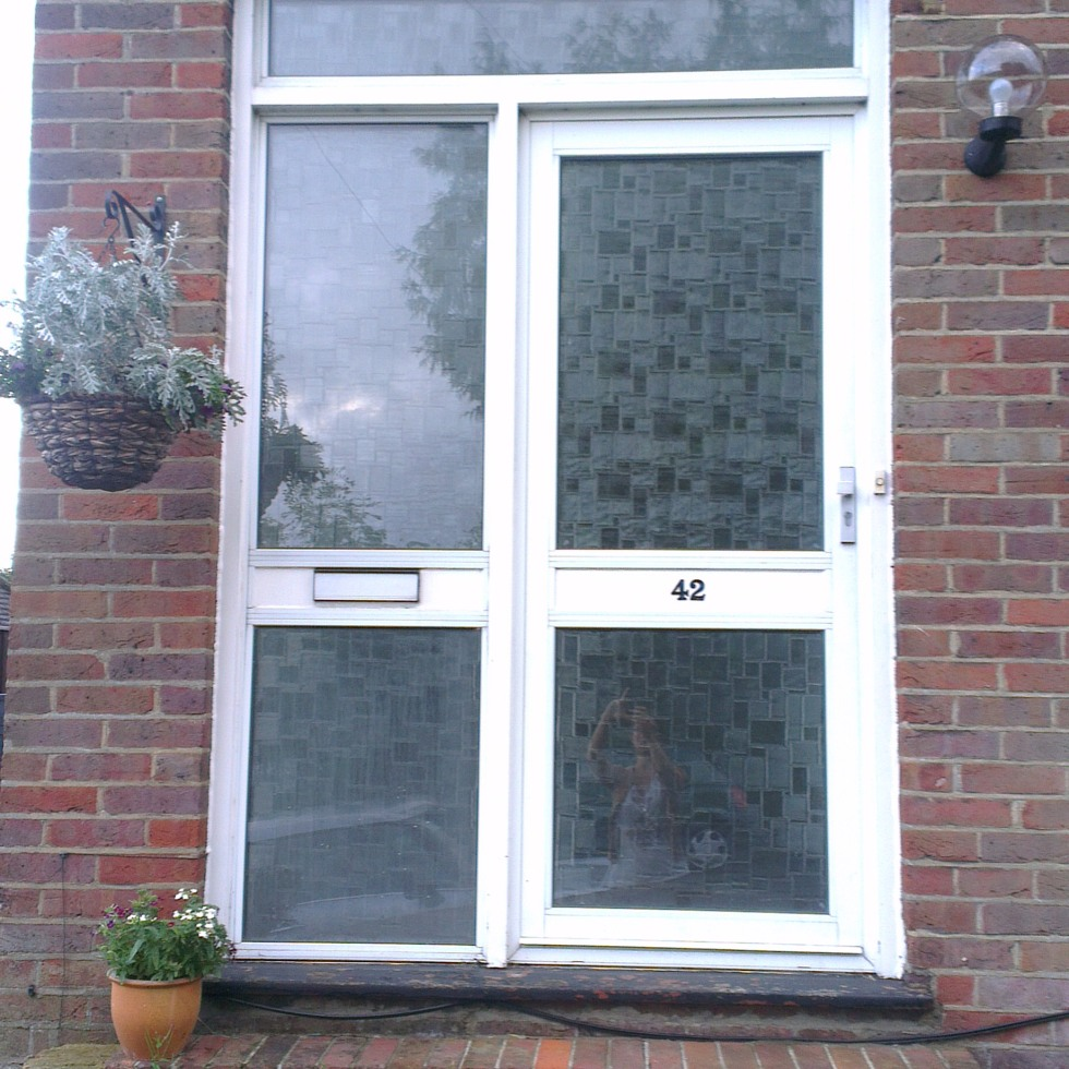 Old glass aluminium front door - before