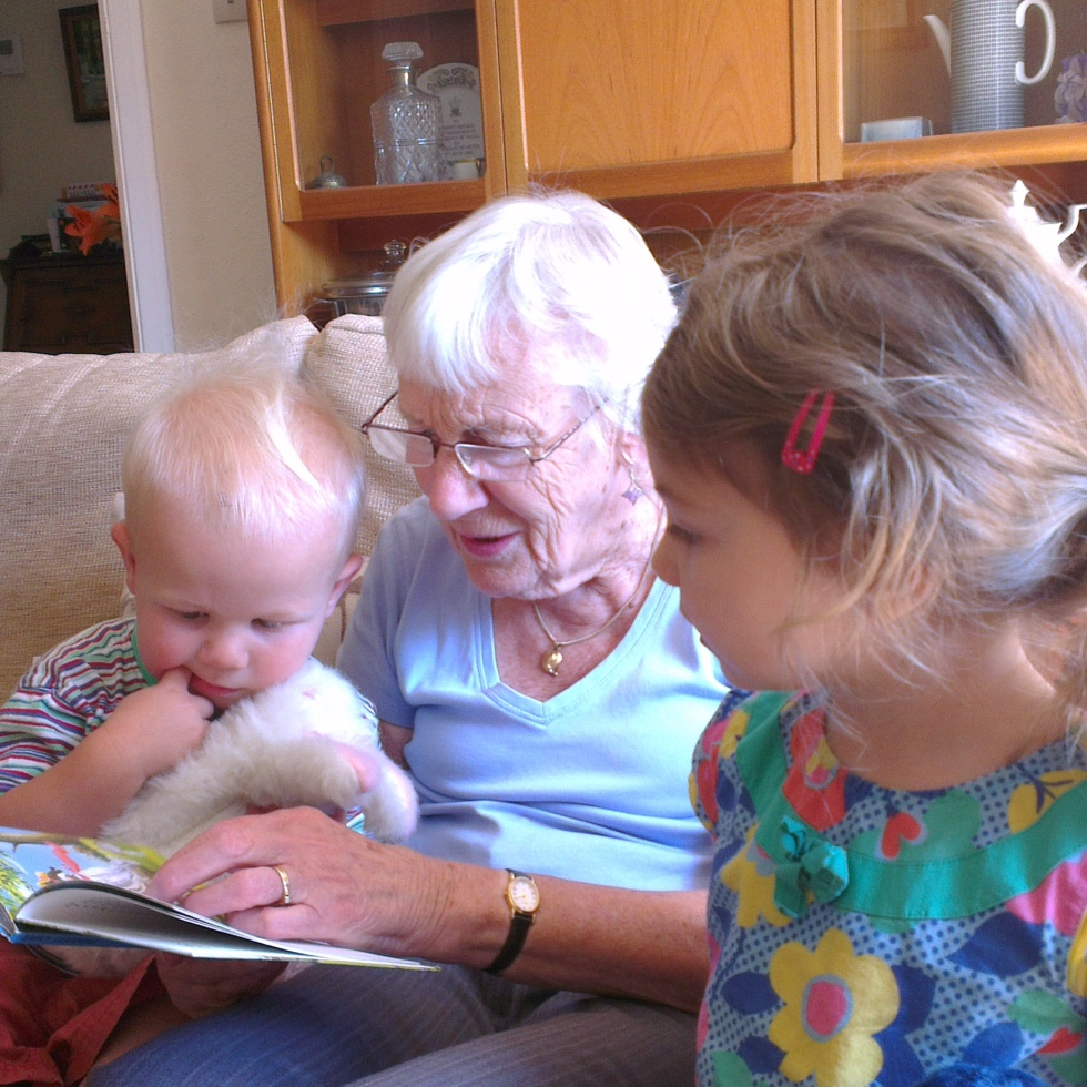 Children and great grandmother reading