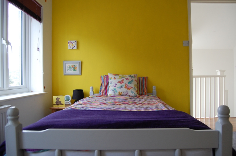 Single bed painted light grey