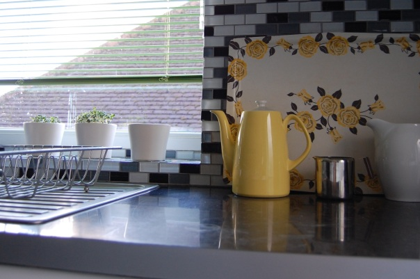 Kitchen window and worktop with coffee pot and jugs