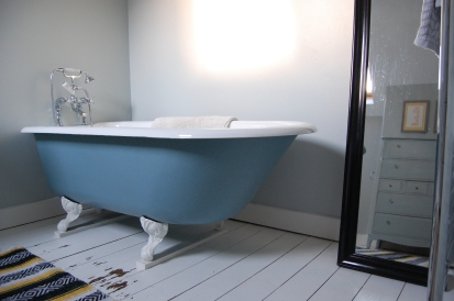 Roll top bath painted bathroom floor