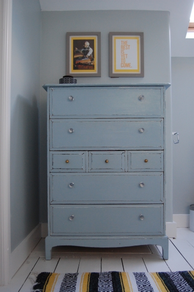 Blu yellow and black bathroom with painted stag chest of drawers
