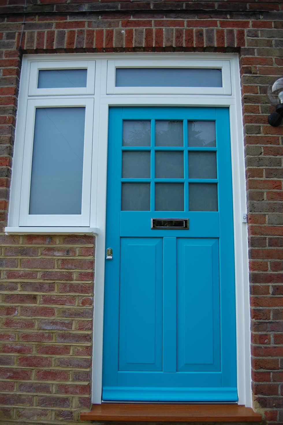 new turquoise front door 50s house