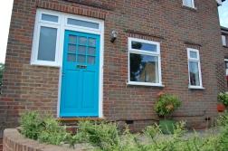 new turquoise front door 50s house