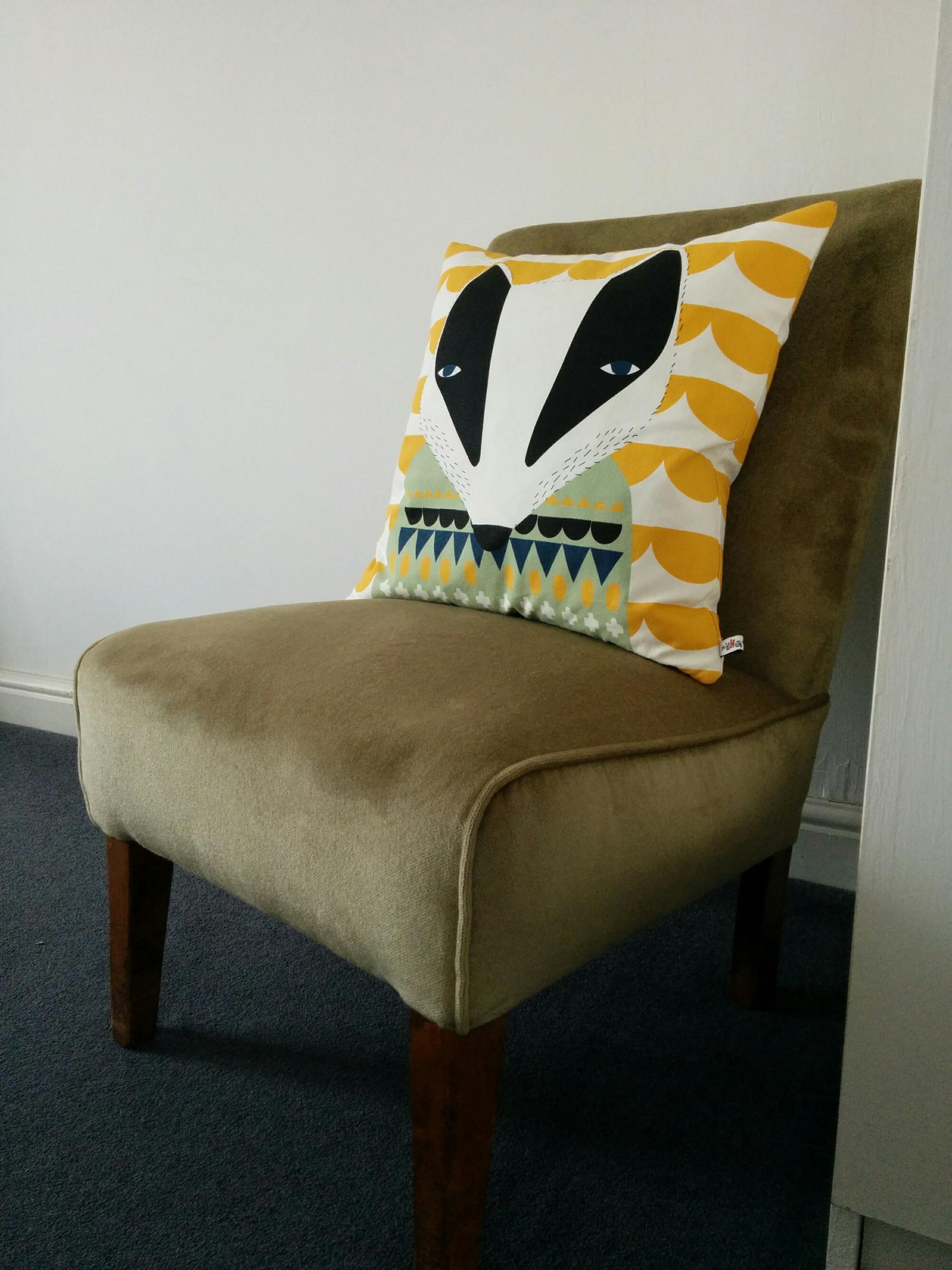 Charity shop mid-century nursing chair with Donna Wilson cushion