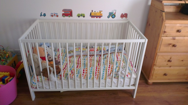 Before: toddler's multi-coloured bedroom makeover