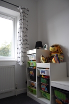 2-year-old boy's bedroom with ikea storage unit and curtains