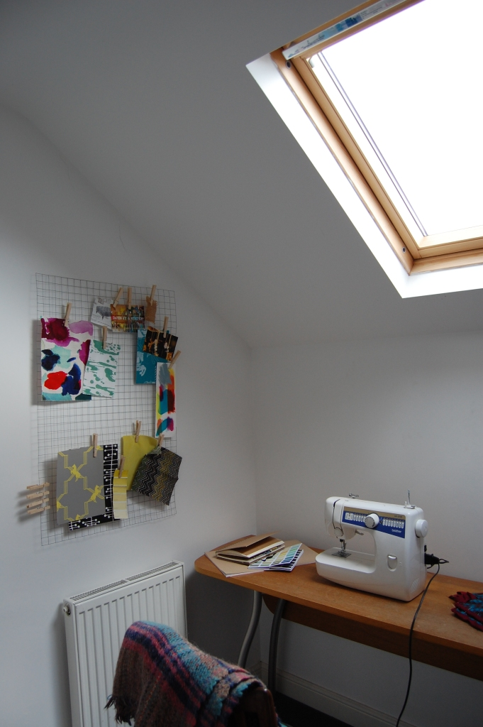 Craft area with sewing machine and ideas board