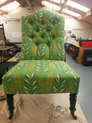 Button-back nursing chair in MissPrint fabric - upholstered by Joanne Mass